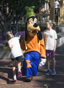 Goofy has some fun with some younger guests at Disneyland near City Hall.