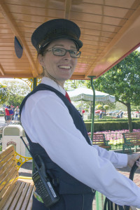 Alyssa, a cast member working on the Main Street U.S.A. Horse Trolley line, prepares to guide her horse down the street from the hub.