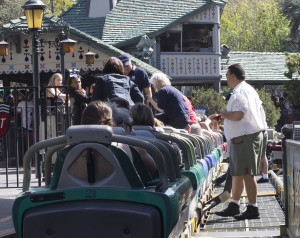 A Disneyland cast member working on the Matterhorn Bobsleds, keeps a watchful eye on park guests exiting their bobsleds after a ride down the mountain.
