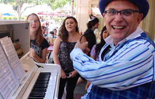 "These three girls sang an impromptu performance of ""Let It Go"" from the Walt Disney Animation film ""Frozen"" at Disneyland's Coke Corner with the Ragtime Pianist."
