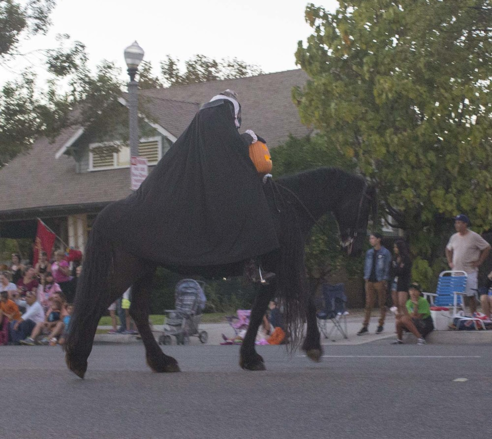 The Headless Horseman rides at the front of the 2014 Anaheim Halloween Parade.
