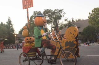 A strange Pumpkin Man rides a bike in the 2014 Anaheim Halloween Parade.