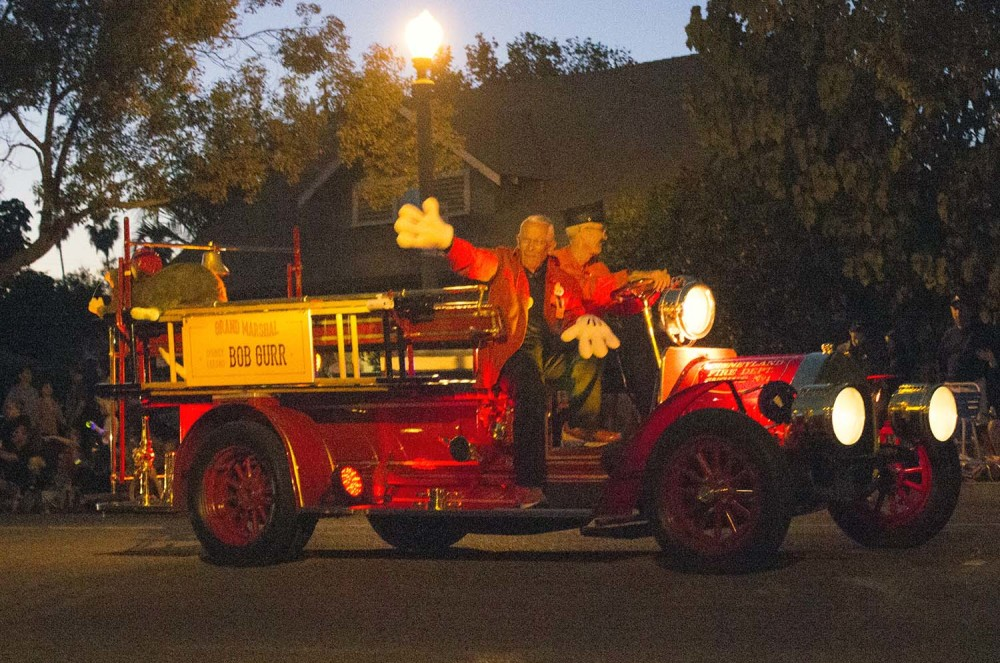The Grand Marshal for the 2014 Anaheim Halloween Parade is none other than Disney Legend and former Imagineer Bob Gurr. Driving the Disneyland Fire Truck is Disneyland Attractions Host Steve Finley.