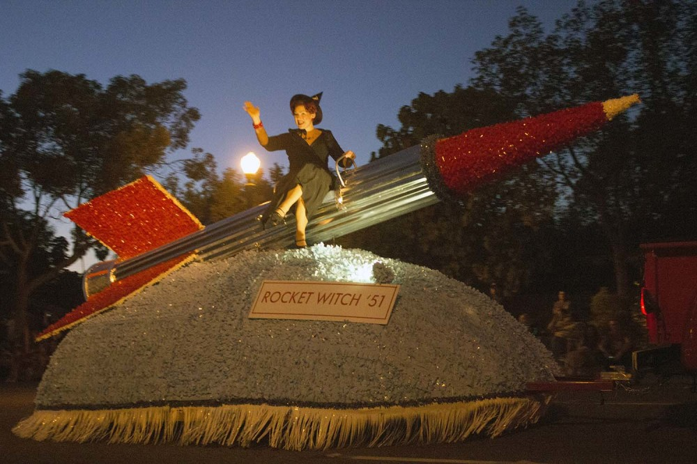 This witch flies a rocket instead of a broomstick at the 2014 Anaheim Halloween Parade.