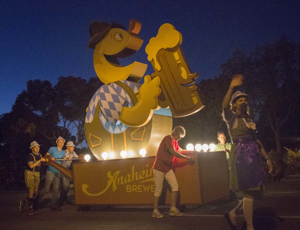 The Anaheim Brewery Boys push their float down Broadway at the 2014 Anaheim Halloween Parade.