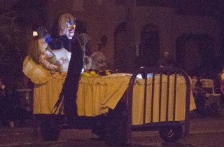 A bed with some scary monsters in the bed, not under it, float down Broadway in the 2014 Anaheim Halloween Parade.