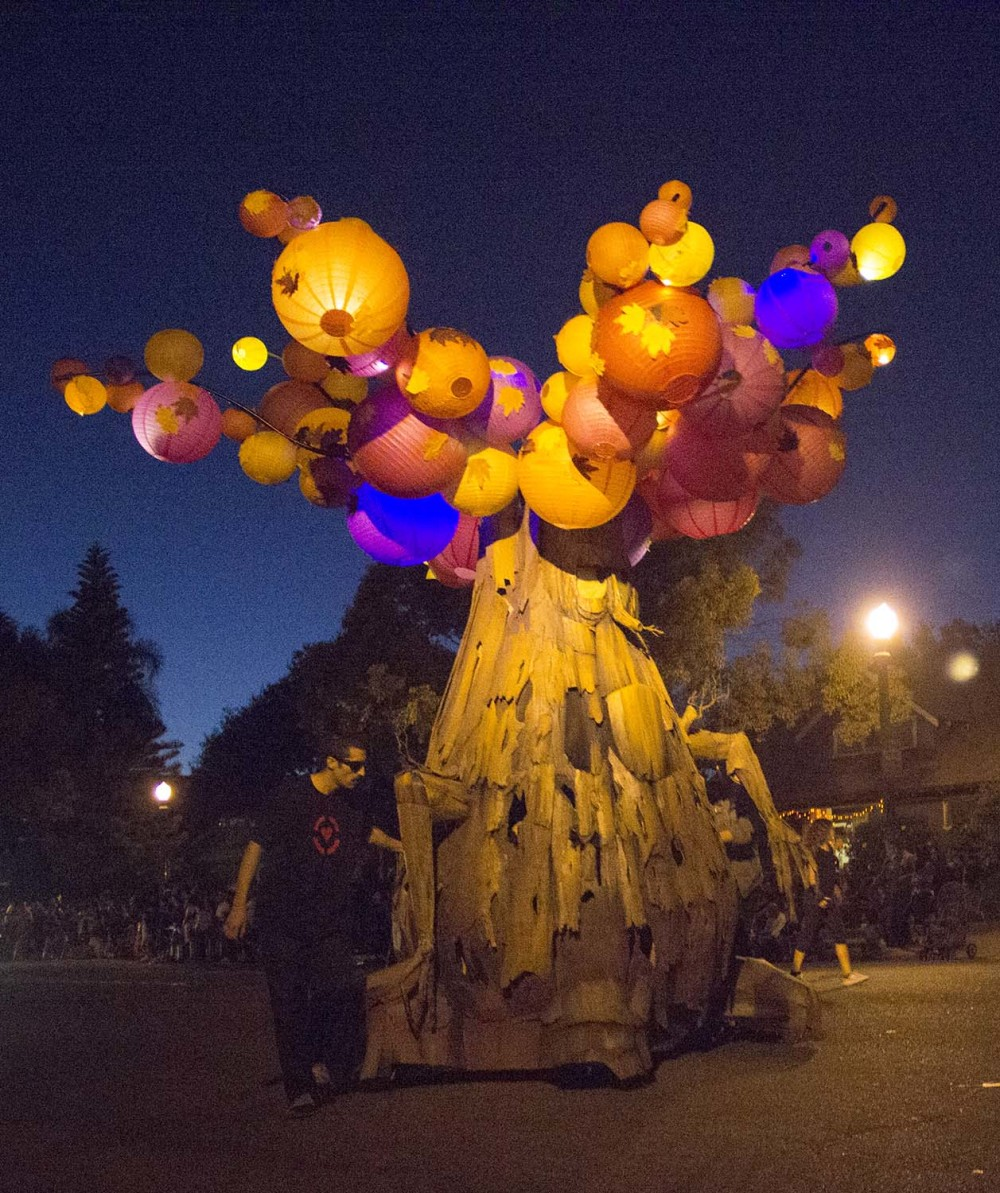 This tree seems to be growing glowing pumpkins at the 2014 Anaheim Halloween Parade.