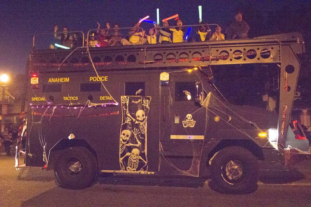 The Anaheim Police Department SWAT car has captured a bunch of Star Wars fans with their light sabers for a ride down Broadway in the 90th edition of the Anaheim Halloween Parade.
