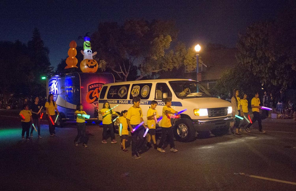 Several Jedi Padiwan learners guard this Anaheim Police Department vehicle near the end of the 2014 Anaheim Halloween Parade.